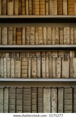 very old books in a shelf - stock photo