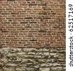 very old brick and worn stone wall - stock photo