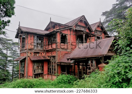 Very old brick house with broken windows - stock photo