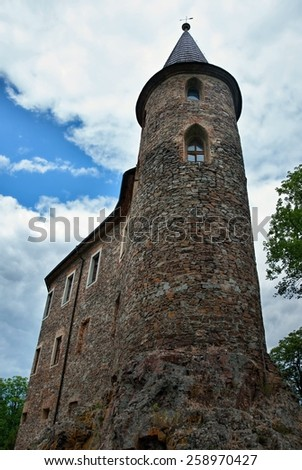 Very old castle built on a high rock - stock photo