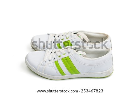 Very old dirty pair of running shoes over a white background - stock photo