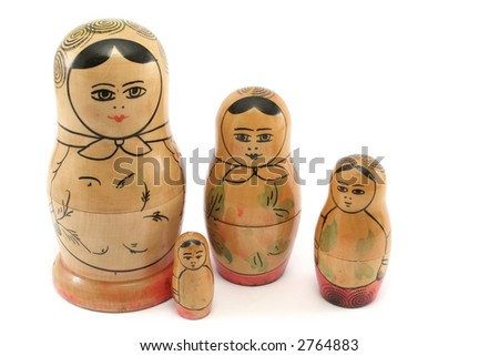 Very old, faded Russian dolls with the baby nestling next to Mother - stock photo