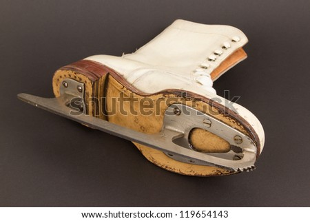 Very old figure skate, isolated on black background, selective focus - stock photo