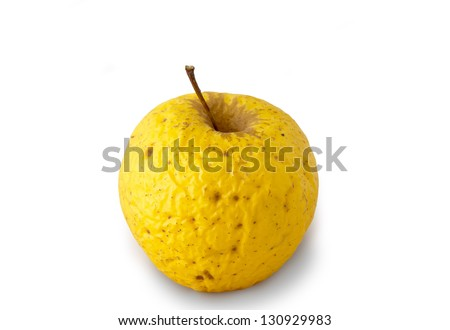 Very old golden apple over white background - stock photo