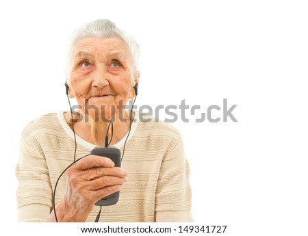 very old lady isolated on white  listening to music on the phone - stock photo