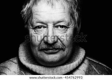 Very old man portrait on dark background - stock photo