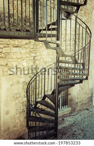 Very old outdoor spiral staircase - stock photo