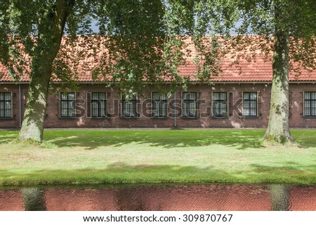 Very old red roof on dutch style house - stock photo