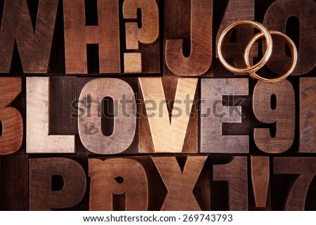 Very Old Vintage Letterpress letters spelling out Love (with rings) - stock photo