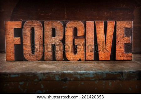 Very Old Vintage Letterpress spelling out Forgive - stock photo