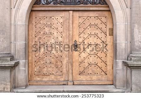 Very old wooden door in the wall - stock photo