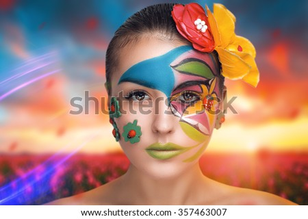 Very positive bright extraordinary picture. Flower Lady Art Makeup. Young smiling girl with creative body-art summer girl. Party leaflet advertisement, cosmetics blog, horizontal photo web-cite banner - stock photo