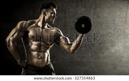 very power athletic guy , execute exercise with dumbbells, on concrete slab background - stock photo