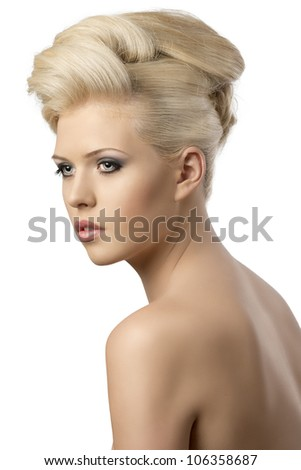 very pretty blonde woman with elegant hairstyle, she is turned of three quarters at right and looks in front of her - stock photo