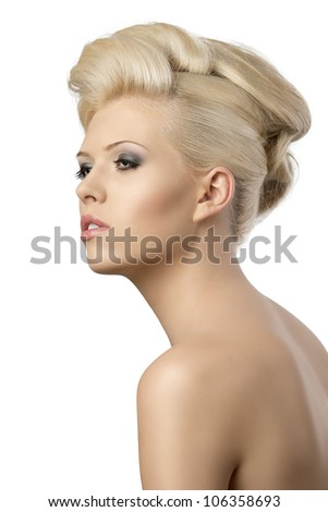 very pretty blonde woman with elegant hairstyle, she is turned of three quarters at right and looks in front of her with dreaming expression - stock photo