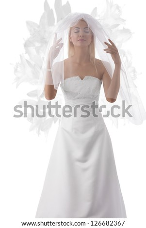 very pretty woman with relaxed expression, wedding dress, white veil over the face, pearls bracelet and some flowers on background - stock photo