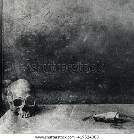 Very scary skull on table. Textured grunge black and white background - stock photo
