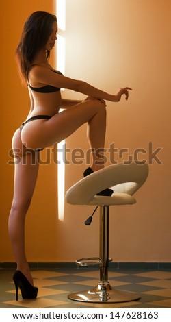 Very sensual slender young brunette model in black lingerie. - stock photo