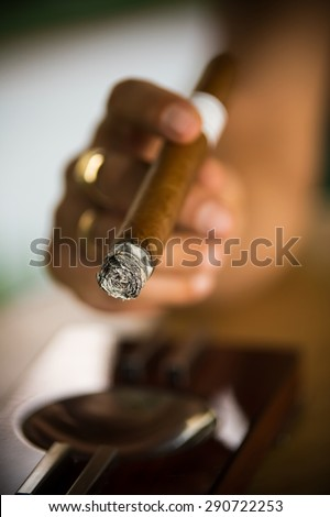 Very shallow focus on fine cigar ash showing proper burn of high quality handmade cigar. See more - stock photo