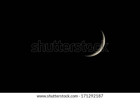 Very Small Early Moon in the Deep of Night - stock photo