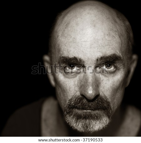 Very Striking Image of an Older man On Black - stock photo