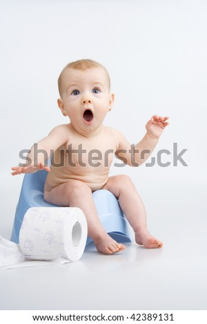 Very surprised little girl on potty with lavatory paper,on white background. - stock photo