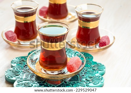 Very taste black Turkish tea drinking, traditional Turkish tea in glasses - stock photo