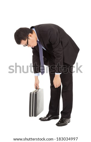 very tired businessman stoop and holding briefcase - stock photo