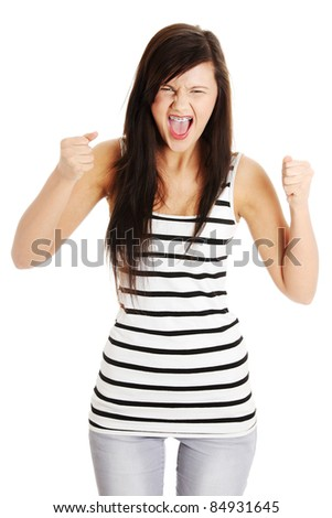 Very upset and angry woman screaming and clenching her fists. Isolated on white. - stock photo