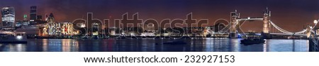 Very wide night panorama of London Tower bridge, Tower and London financial City district.  - stock photo