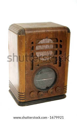 Very worn, dusty, and well-used vintage classic wood tabletop radio with a retro look.  Shot isolated on white background. - stock photo