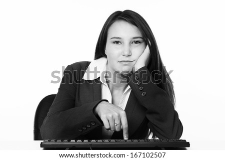 very young looking woman looking bored and not happy at work cant wait to go home - stock photo