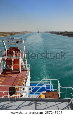 vessel passes through the Suez Canal. Egypt - stock photo