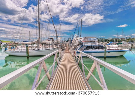 Vessels moored in Pine Harbor , Auckland , New Zealand - stock photo