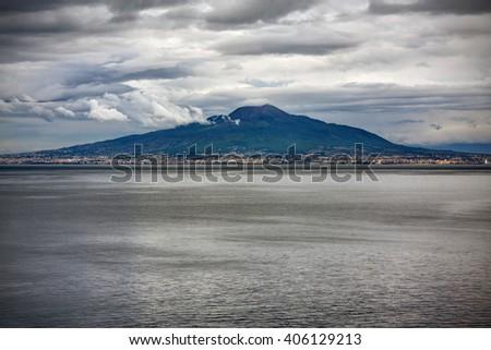 Vesuvio volcano and Naples seen from the sea (photo taken in Sorrento, Italy) - stock photo