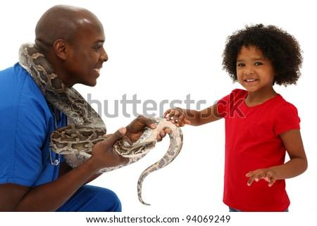 Vet and Preschool Child Snake Owner Helping Pet Over White Background Python - stock photo