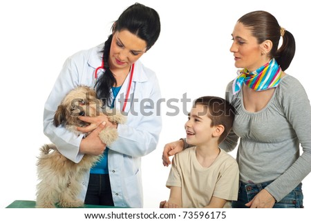 Vet doctor examine puppy dog and his family looking  at them isolated on white background - stock photo