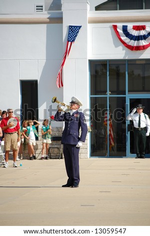 Veteran playing taps at Memorial Day ceremony - stock photo