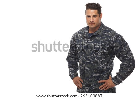 Veteran soldier   Portrait of navy man with hands on hips - stock photo