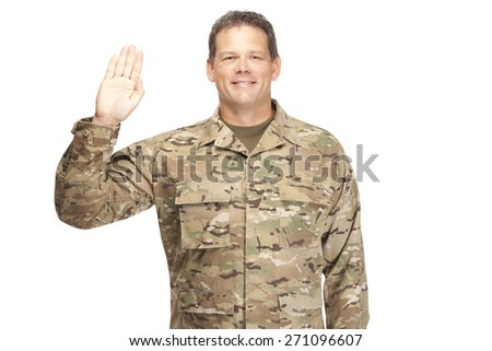 Veteran soldier, Sergeant. Isolated. Smiling while taking oath of enlistment. - stock photo