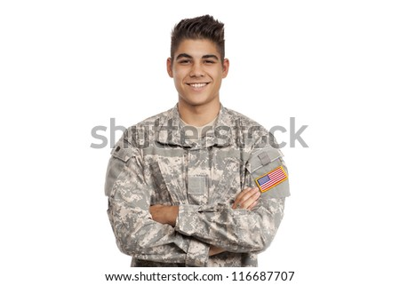 VETERAN SOLDIER   Smiling serviceman with his arms crossed - stock photo