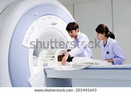 veterinarian doctor working in MRI scanner room - stock photo