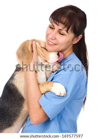 veterinarian hugging puppy. isolated on white background - stock photo