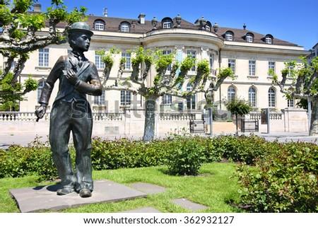 VEVEY, SWITZERLAND - 24 MAY: Bronze statue of comedian actor Charlie Chaplin on the promenade in Vevey (Vaud), Switzerland on May 24,2010. - stock photo