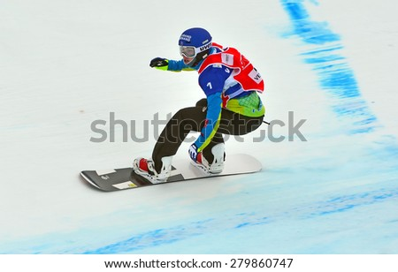 VEYSONNAZ, SWITZERLAND - MARCH 14:  Nelly MOENNE LOCCOZ (FRA) competing in the finals of the Snowboard Cross World Cup: March 14, 2015 in Veysonnaz, Switzerland - stock photo