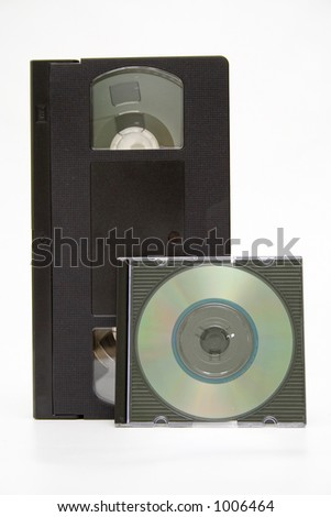 VHS cassette and CD disc on white background - stock photo