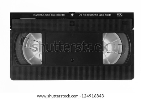 VHS video tape cassette isolated on white background - stock photo