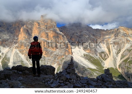 "Via ferrata ""Lipella"" climber standing in front of Fanes massif, Dolomite Alps, Italy - stock photo"