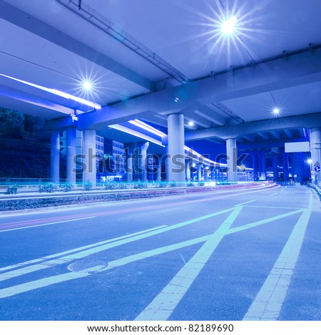 Viaduct car traveling light trails at night - stock photo