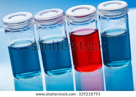 vials filled with colored liquids - stock photo